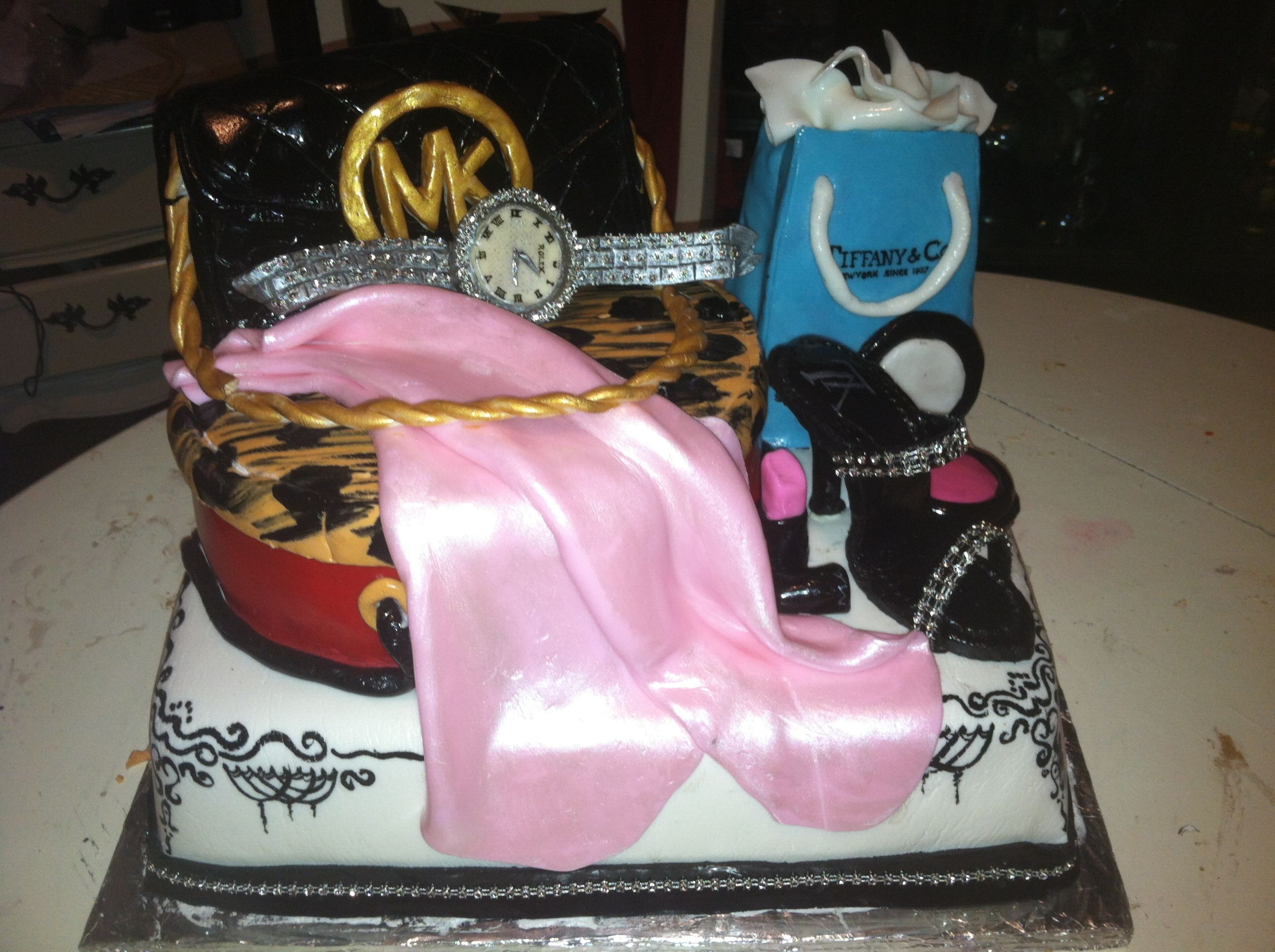 A female delight cake feat. Michael Kors bag , Rolex watch n many more edible items