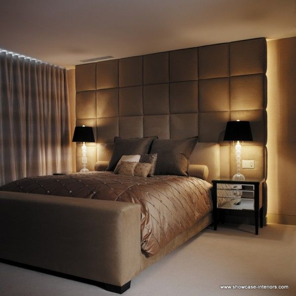 A Custom Bed With Upholstered And Back-lit Headboard