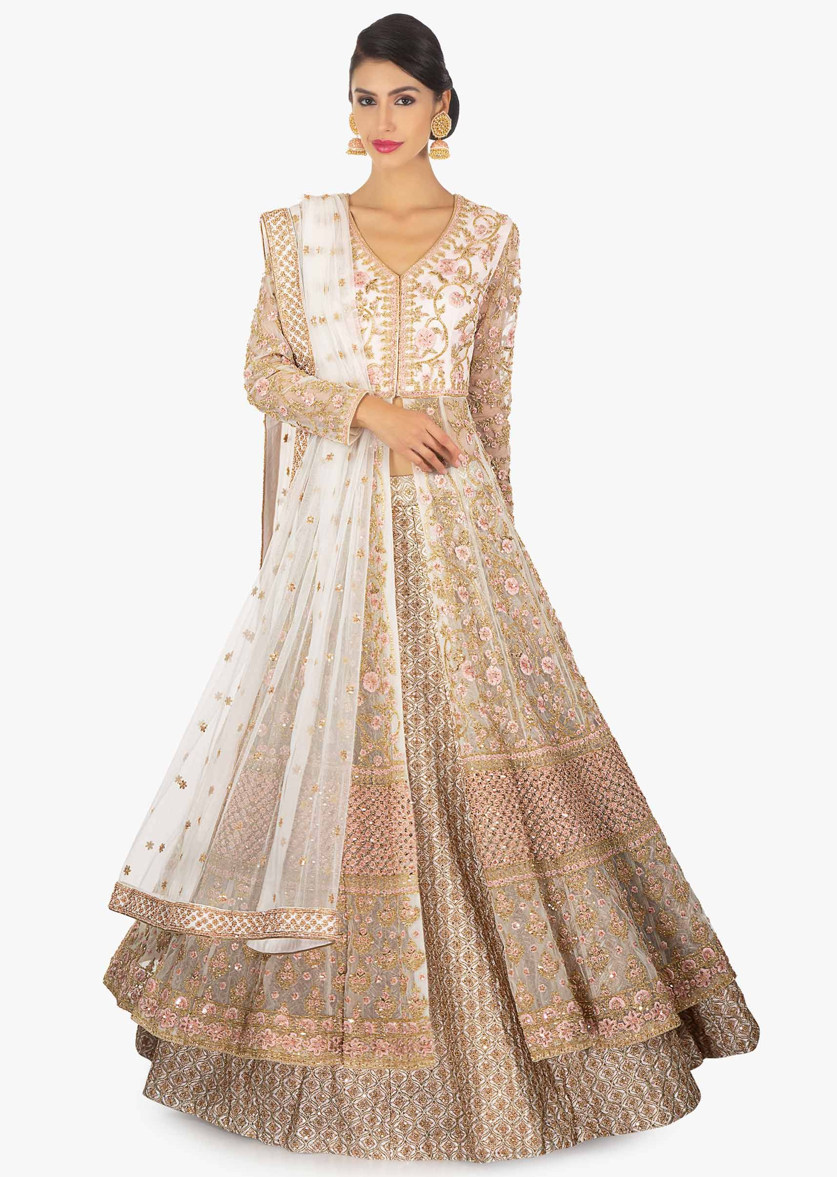 0a64842cf937f8 Off white zari lehenga paired with a long net embellished jacket only on  Kalki