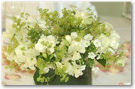 Arrangement of White Phlox, Freesia, Alchemilla Mollis, Roses and Sweet Peas wedding flowers