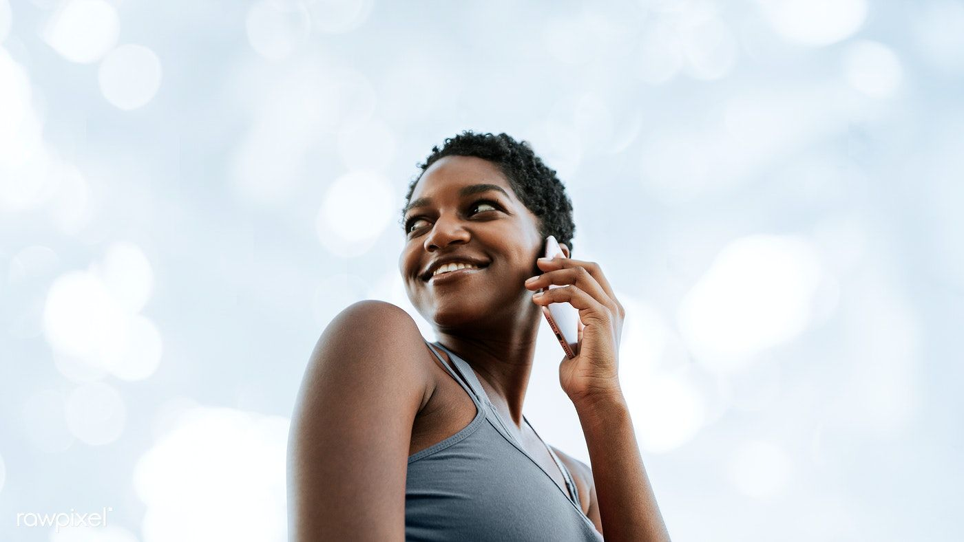 Download premium image of Black woman talking on the phone