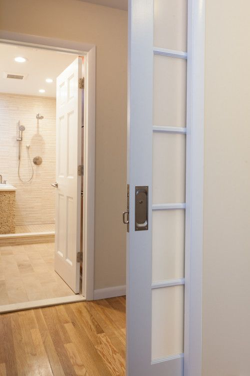 Frosted Glass Pocket Door Leads To This Zen Sanctuary Behind This Interesting Bathroom Remodeling Leads