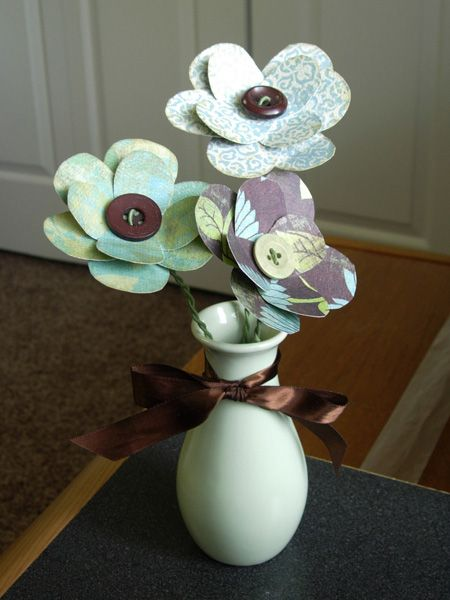 paper flowers made from paper hand cut into figure 8 shapes--cute, don't need water, and don't die!