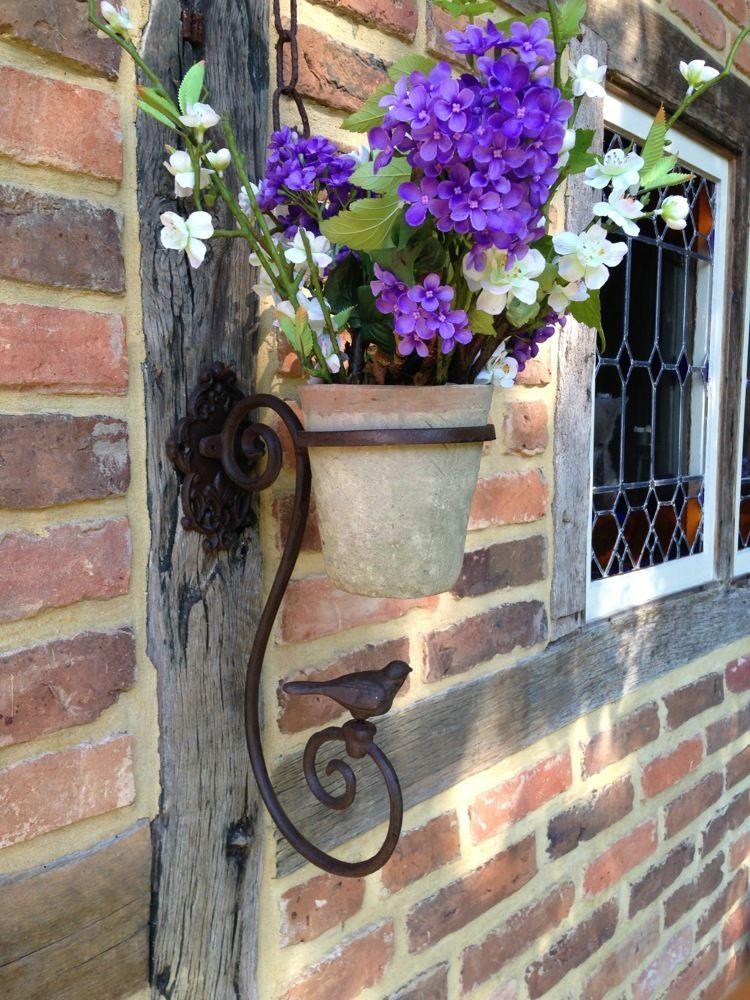 Wandhalterung vogel mit blumentopf terracotta pflanztopf for Wandhalterung pflanzen