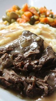 Slow Cooker Sirloin Steak with Gravy Recipe. Fork tender sirloin steak served with buttery mashed potatoes and covered in gravy.