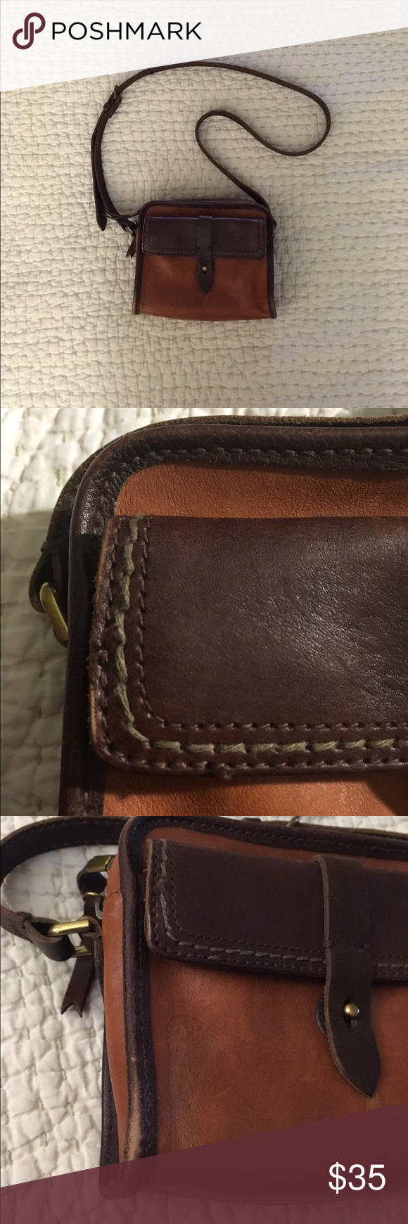 c084c4989eda Madewell Heritage Leather Camera Bag Genuine leather. This bag has a water  stain on he front as pictured. There is also wear on the corners.