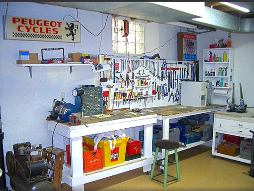 Basement workshop clean and organized awesome i need for Small basement workshop ideas