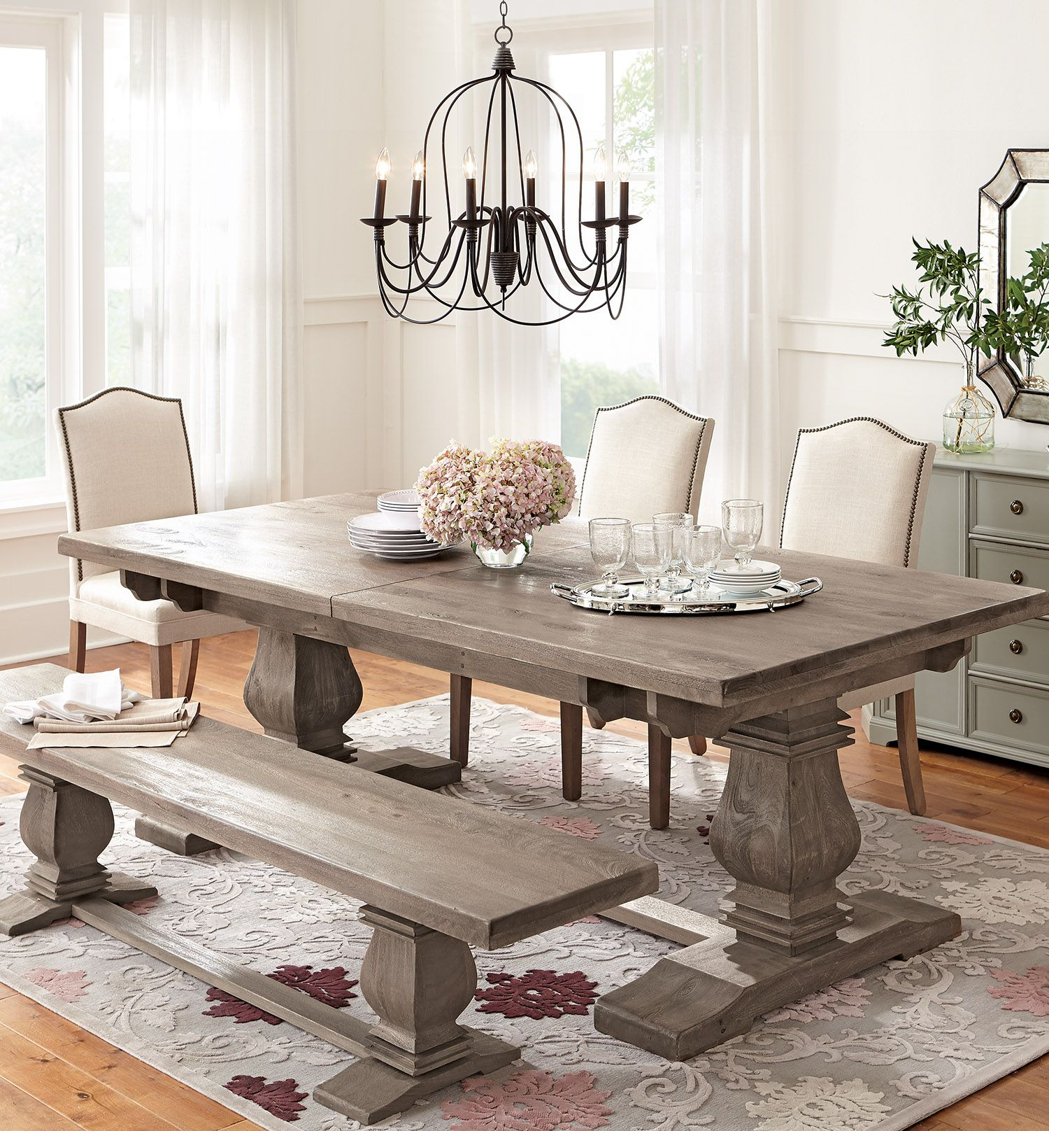 Simple Neutral Dining Chairs Allow For A Patterned Rug And Stunning Table To Shine