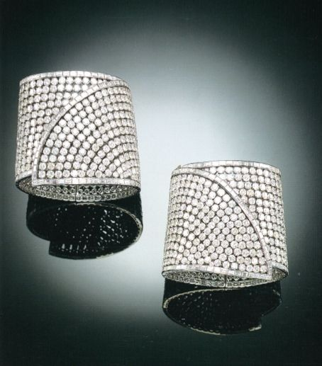 A PAIR OF HIGHLY IMPRESSIVE DIAMOND CUFF BRACELETS, BY TABBAH