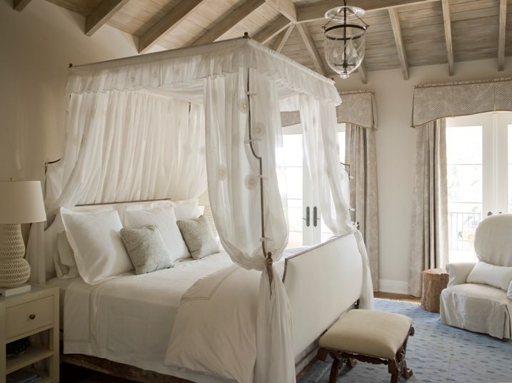 Dreamy Bedroom With Iron Canopy Bed White Upholstered Headboard And Footboard Blue Damask Pillows Oly Studio Pipa Lamps On Cream Nightstands