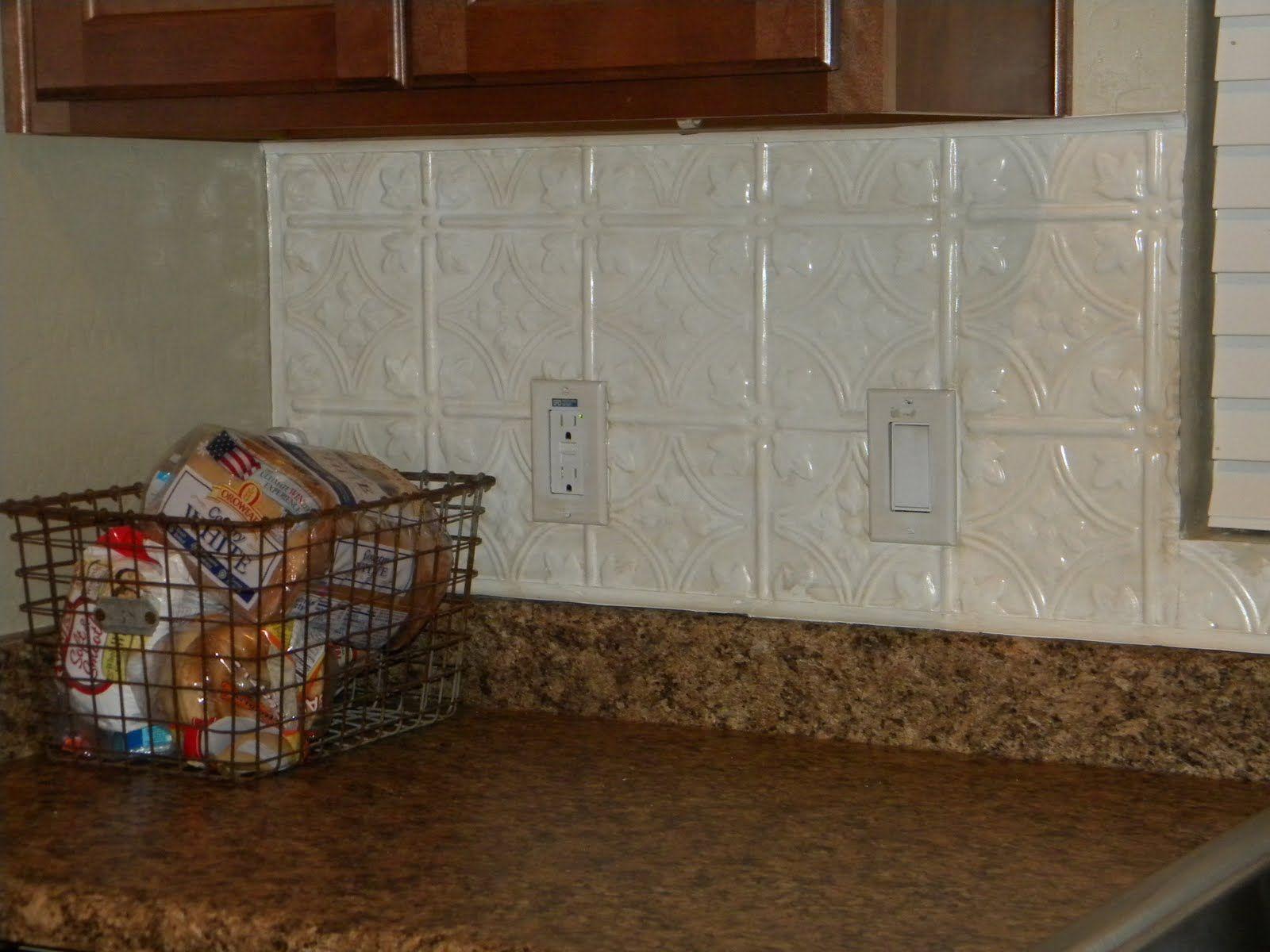 Tin tile backsplash painted with a bit of glazing