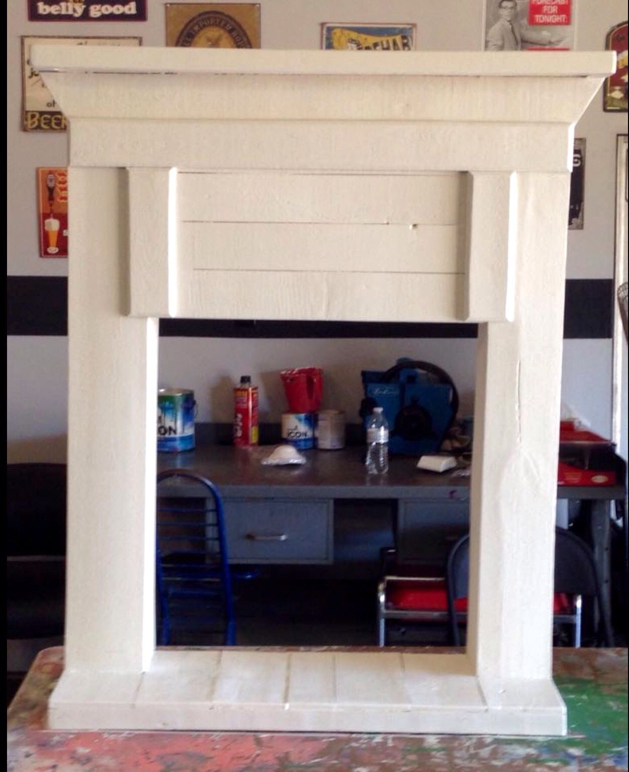 Faux Fireplace made from old pallets with a fresh coat of paint