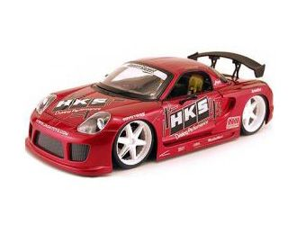 This Toyota MR2 Spyder Diecast Model Car is Red and features working steering, wheels and also opening bonnet with engine, boot, doors. It is made by Jada and is 1:18 scale (approx. 25cm / 9.8in long).  ...
