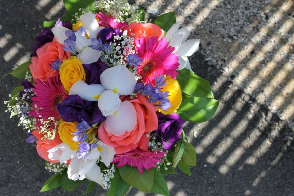 Bouquet of White Iris, Gerberas, Yellow and Peach Roses, Statice, Purple Mini Carnations and Lemon Leaf