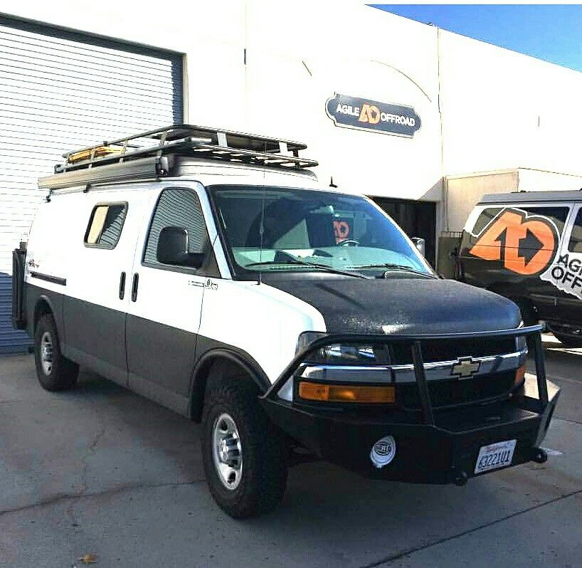 Chevy Van With Aluminess Roof Rack And Bumpers