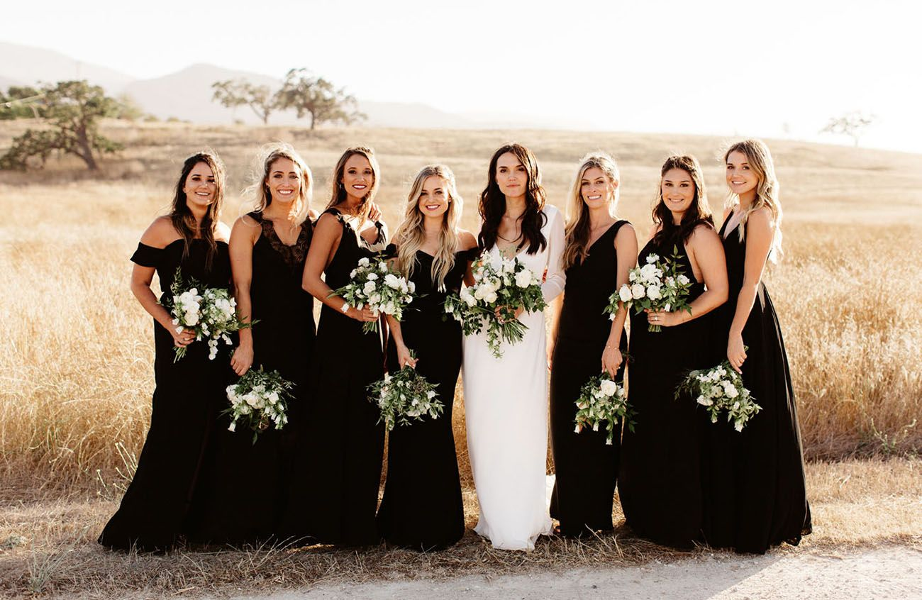 A Black Tie Affair Modern Countryside Wedding With Luxe Boho Accents Green Wedding Shoes Black Bridesmaid Dresses Black Bridesmaid Dress Mismatched Black Bridesmaids [ 846 x 1300 Pixel ]