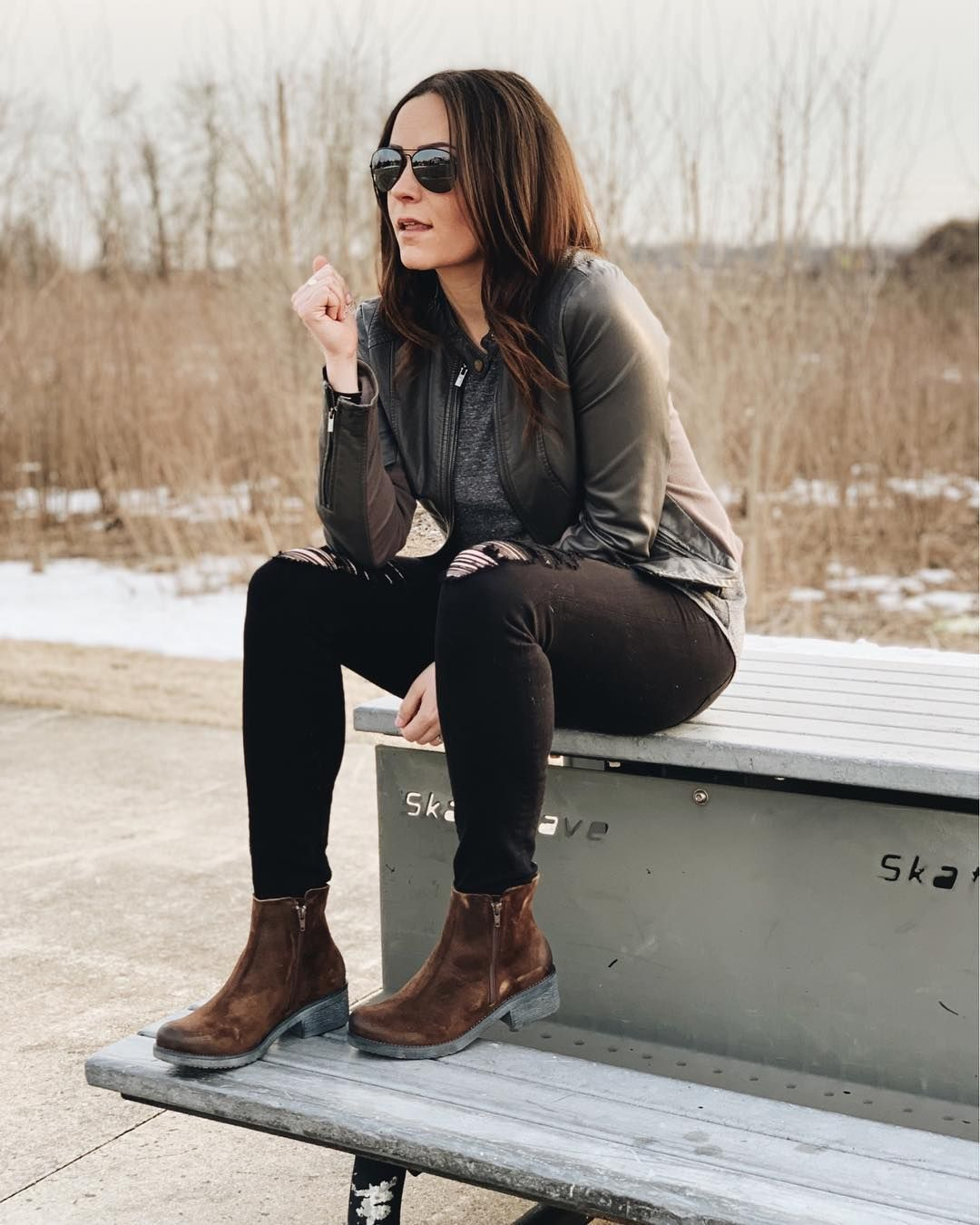 Faux leather jacket, black jeans, and brown boots