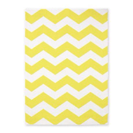 Yellow/white chevron area rug