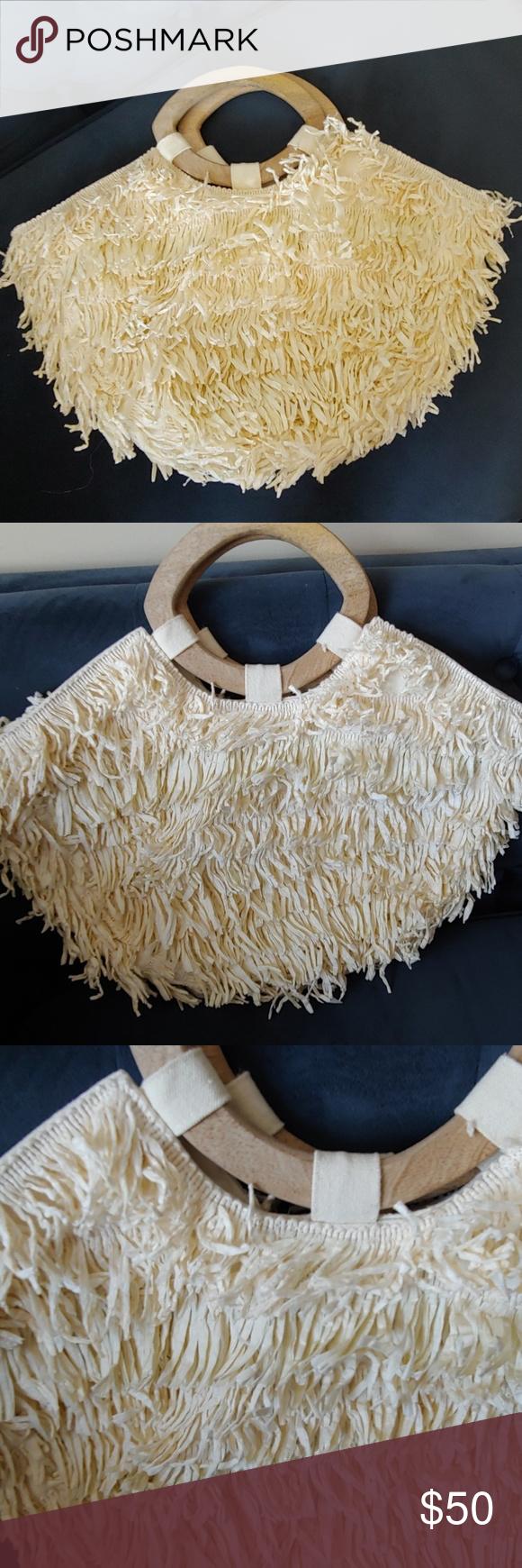 Anthropolgie NWT Rosalita Raffia Tote Bag NWT Anthropolgie Raffia Bag with wooden handle Rosalita fringed tote bag Anthropologie Bags #woodentotebag