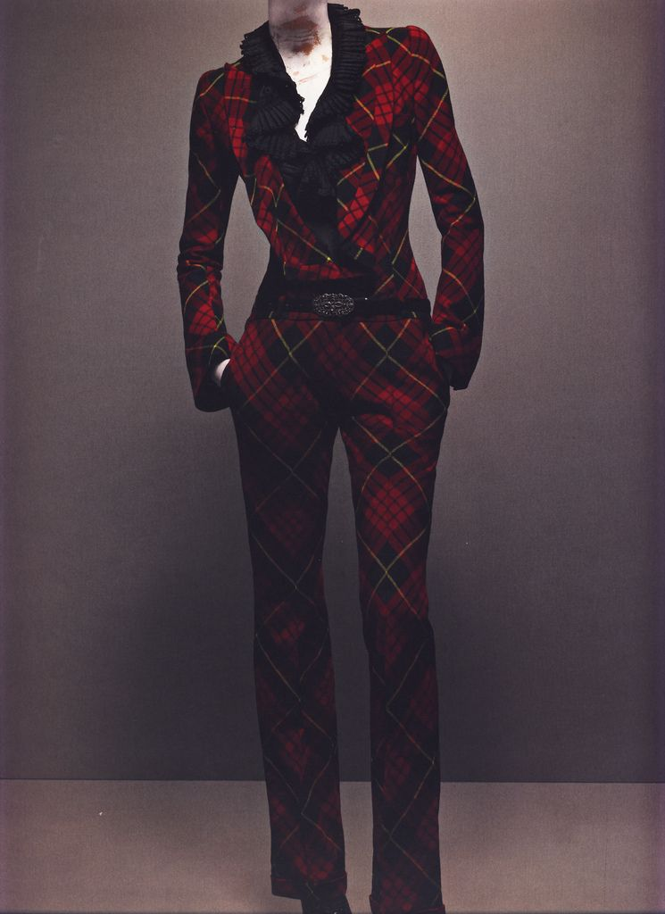 """Alexander McQueen Autumn/Winter 2006-07  Jumpsuit, Widows of Culloden McQueen tartan; ruffled shirt of black cotton with broderie anglaise   Photographed by Sølve Sundsbø for Alexander McQueen: Savage Beauty   """"During the nineties, care and attention to detail got lost somehow. This collection is about going back to [a] level of refinement. Every piece is unique and has emotional content. I want to create pieces that can be handed down, like an heirloom."""""""