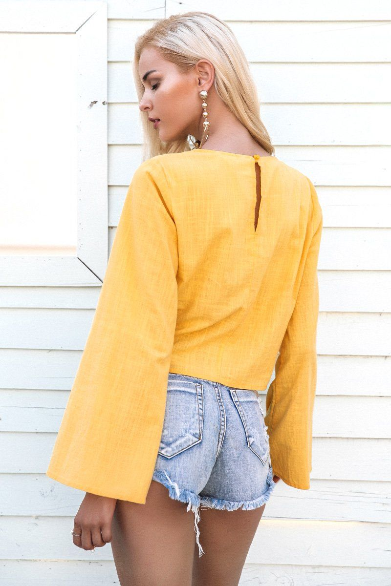 72f43ee3 Flare it out, girl! Loving our Autumn Cross Flare Blouse featuring wide flared  sleeves and a peephole back and tucked knot detail on the front.