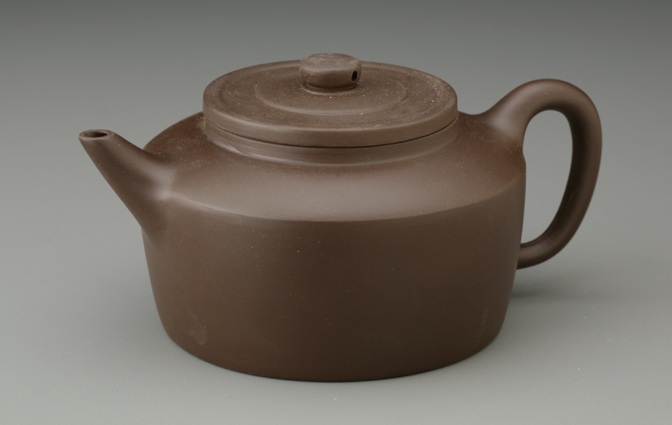 """Mark T. Wendell - Canton 11 oz. Yixing Teapot.  Yixing (pronounced """"ee-shing"""") Teapots first appeared in the Yixing region of China, during the Sung Dynasty (960-1279 ME). Since then, they have become the preferred tea brewing vessel of the Chinese and of tea drinkers worldwide. Yixing teapots are intended for individual use, producing 1-2 servings of tea."""