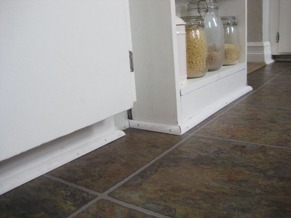 Quarter round moulding added to base of cabinets   Baseboards