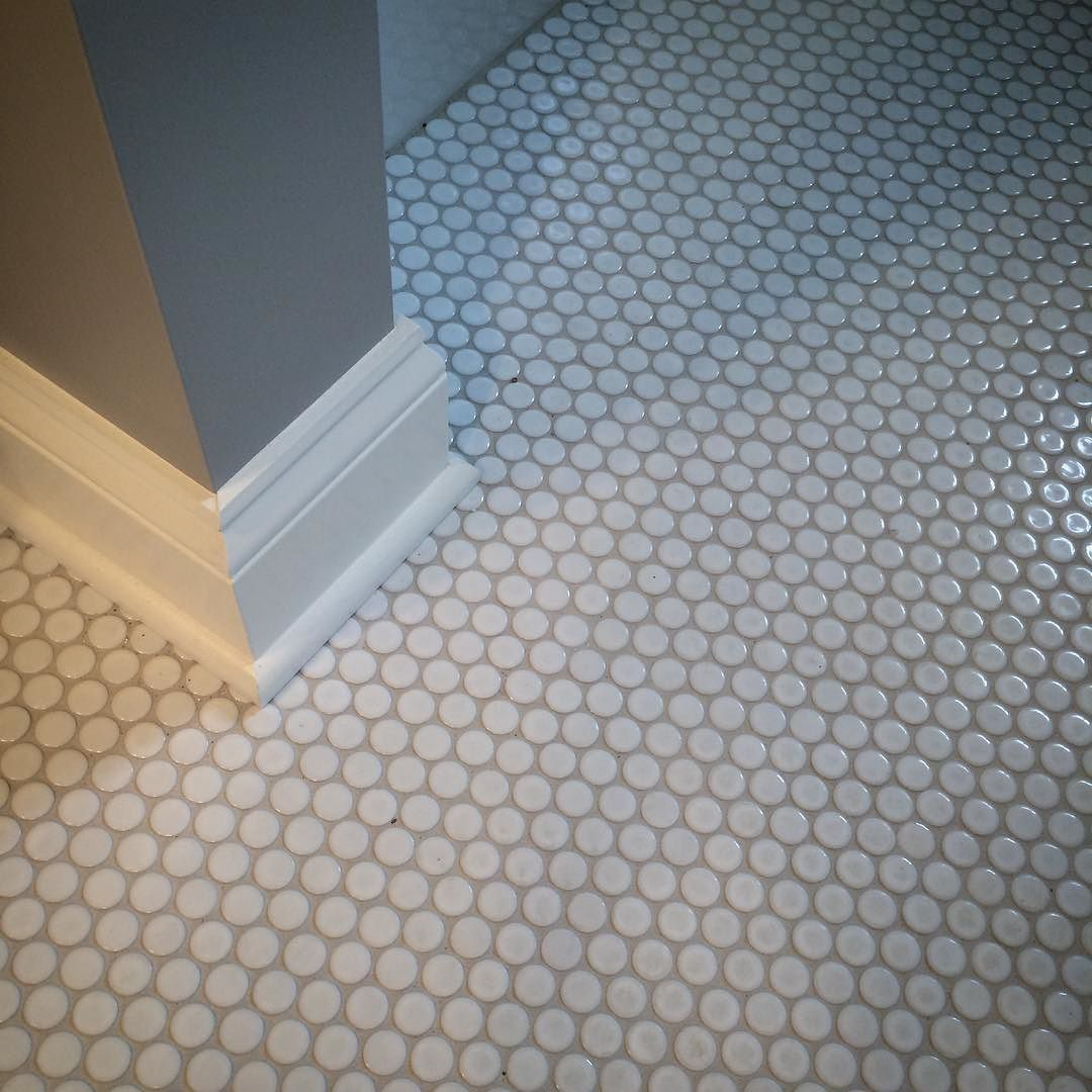 a mosaic of ceramic dots... gloss white with silver shadow grout ...