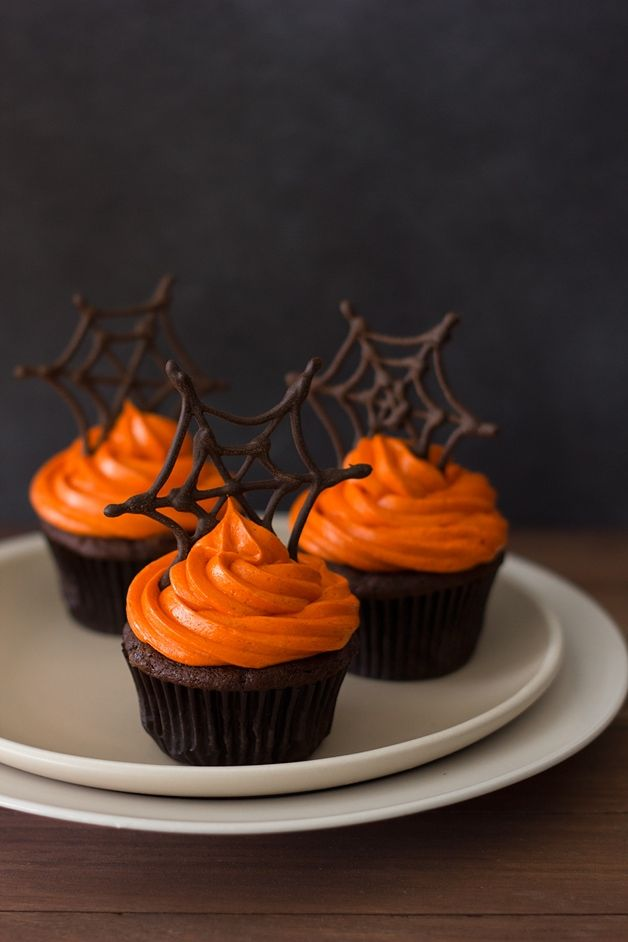 Photo of Halloween Pumpkin Chocolate Spiderweb Cupcakes | Bright-Eyed Baker