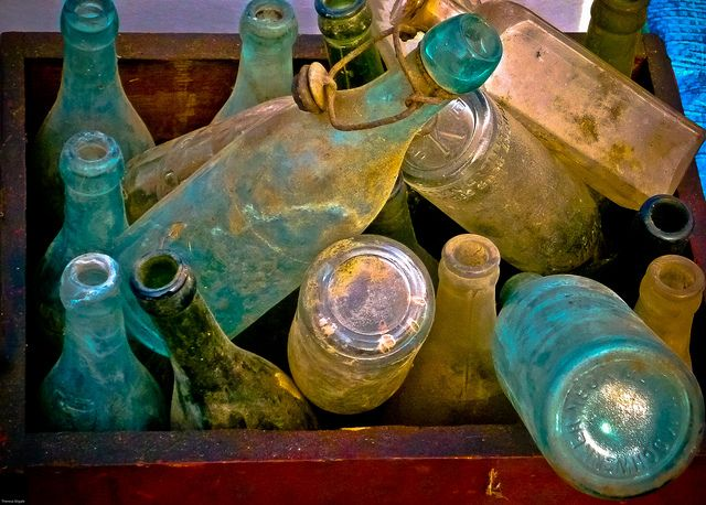 Vintage glass bottles by PhiladelphiaPhotos, via Flickr