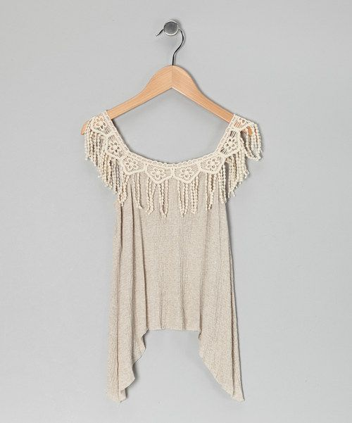 Lovely lace, fluttery fringe and a soft, sophisticated silhouette—this top may be named after the desert, but it's actually a fashion oasis! 97% rayon / 3% nylon spandexMachine wash; tumble dryMade in the USA