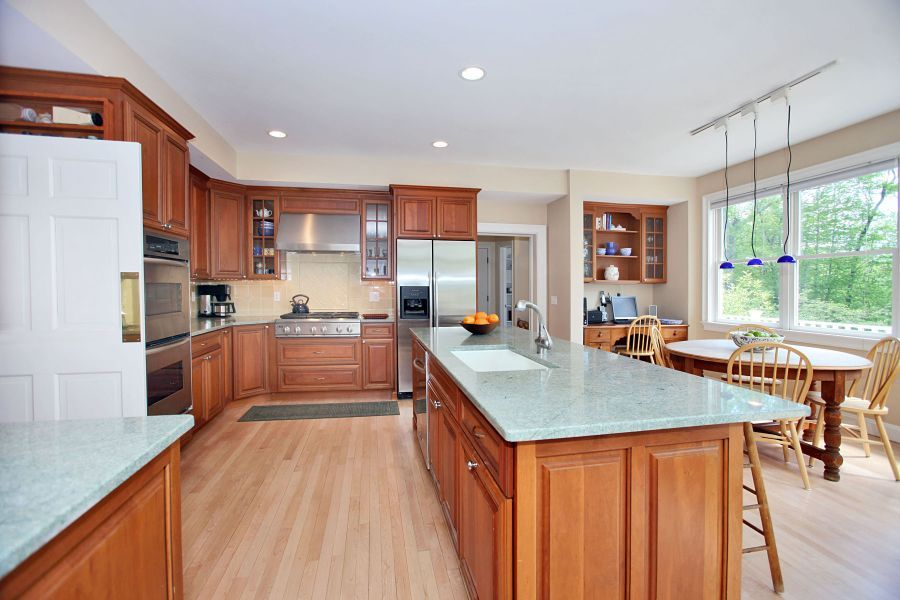 Fabulous renovated kitchen with a wonderful dinette area and lots of windows! The interior floor plan has a great flow for everyday living and entertaining! #20blacksmithridgeroad #thechipneumannteam #neumannrealestate #ctrealestate #ctlistings #beautifulhomes #beautifulkitchens