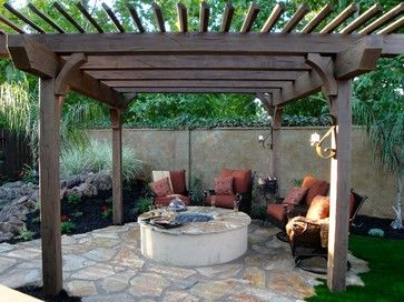 Pergola Over Stone Fire Pit For Pleasant Conversation Area A Stand Alone Fire Pit Would Be Nice For A More Bohemian Fee Fire Pit Pergola Pergola Backyard Fire