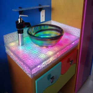 Charmant The Shower And LED Sink Made From Irridescent Lava Uses 3form Eco Friendly  Resin To Hide 100 LEDs Under A Dinosaur Stomped Finish That Looks Like It  Belongs ...