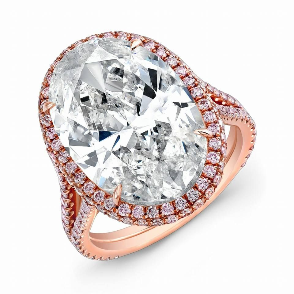 One of a kind #NormanSilverman ring, 10 carat oval cut diamond with pink pave diamonds in 18K rose gold