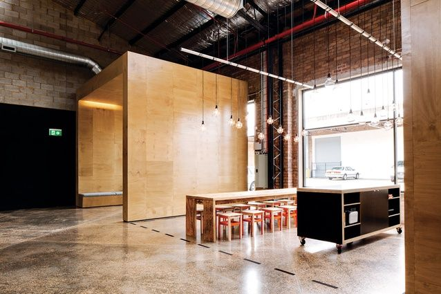 the kitchen's communal dining table was made from scrap timber