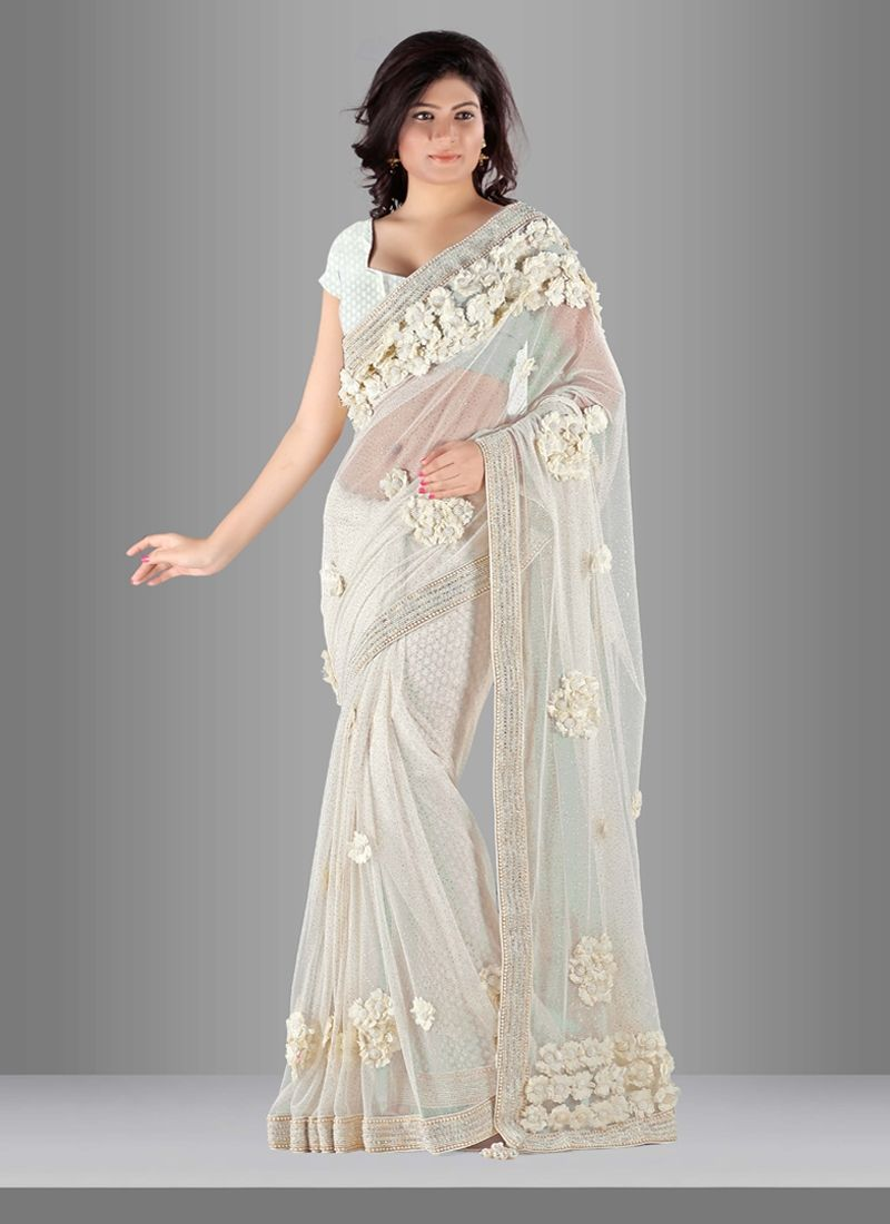 Capture the exuberance of womanhood in its full glory that will bring out your fragility and femininity. Add grace and charm to your look in this desirable jute net designer saree. The ethnic diamond ...