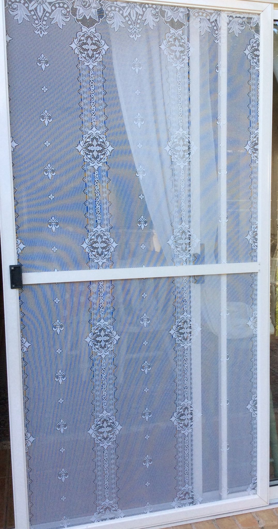 I got the idea off pinterest to put lace on a window screen so i i got the idea off pinterest to put lace on a window screen so i put lace on my sliding door screen and to make it stronger i will spray it with vtopaller Choice Image