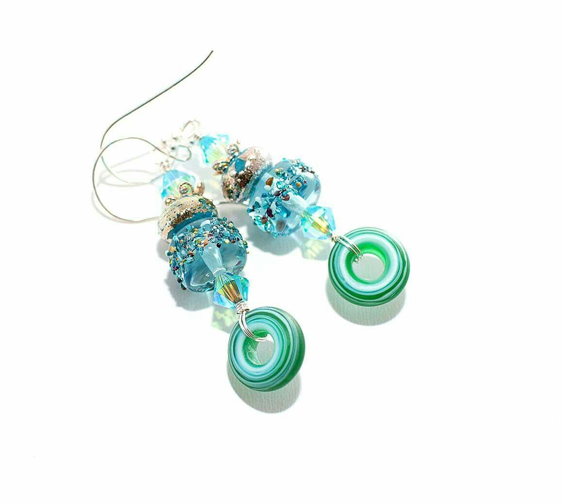 Loving these earrings from the wild woman that is Meredith! Featuring my blue beachcomber beads!  Just two light and luscious inches long on sterling silver artisan wires and in seaside colors.  Perfect for July, and always.  etsy.com/shop/wildwomanbeads  www.facebook.com/wildwomanbeads  #glitteringprizeglass #collaboration #handmade #giftforher #earrings #lampwork #artisan