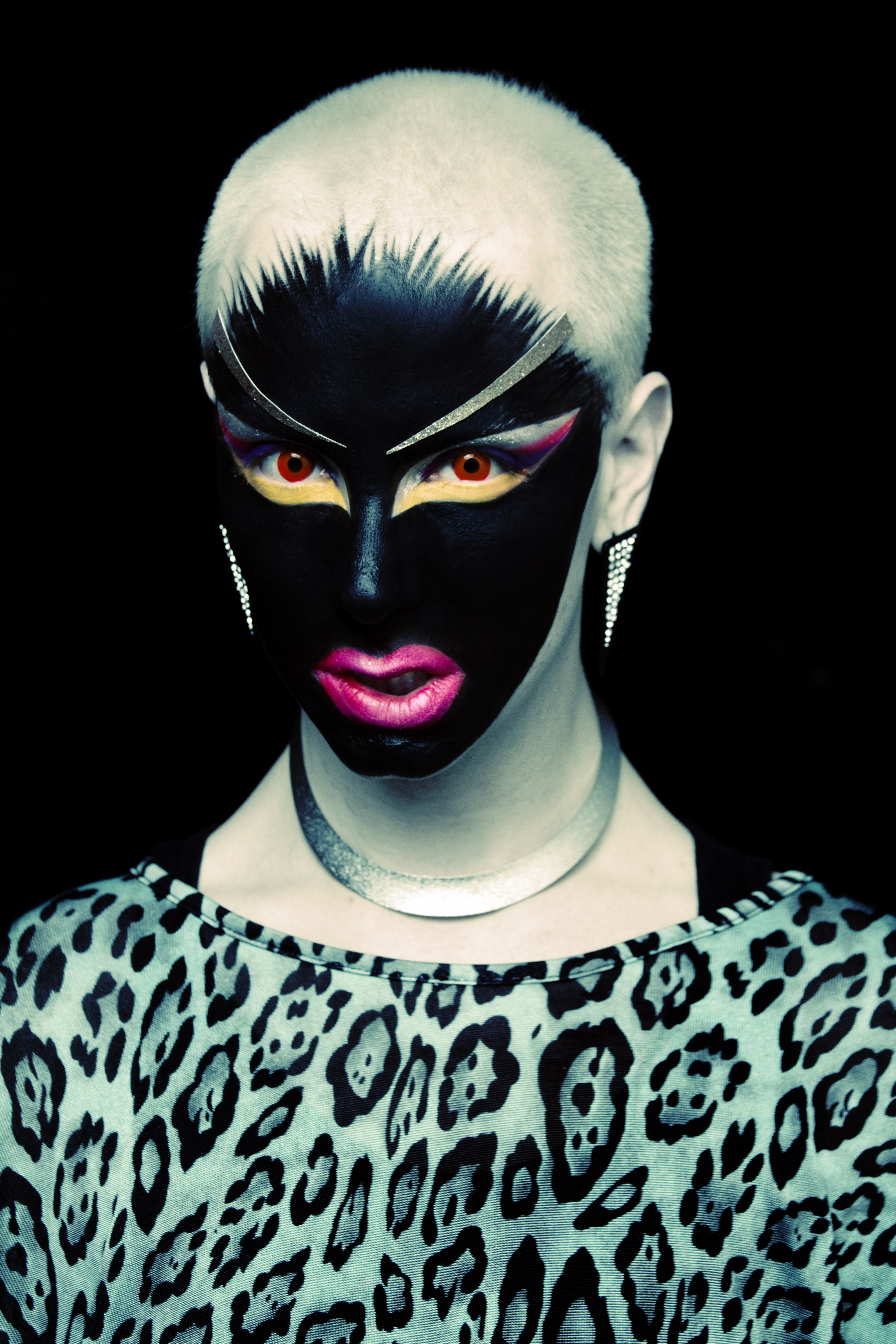 Unknown artist. This makeup is very bird like, cool AND