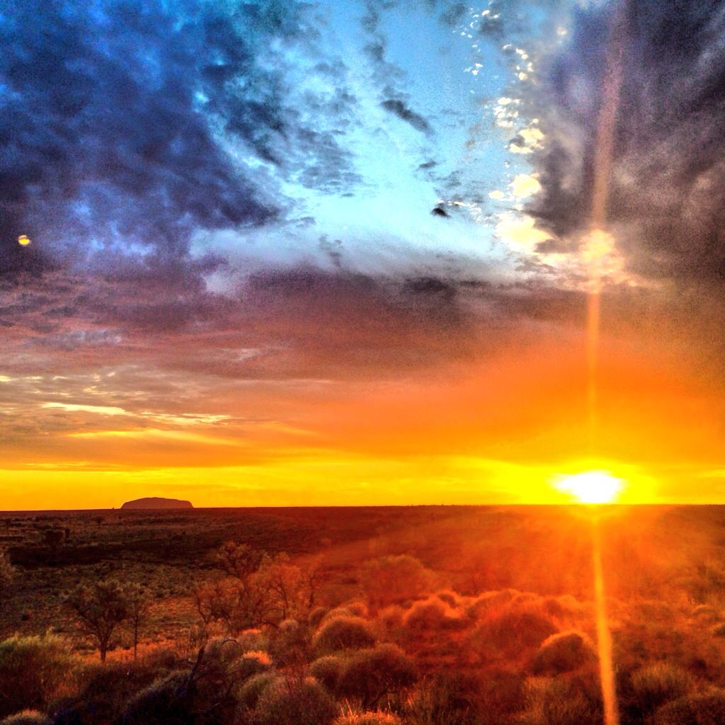 Early morning sunrise photo of Uluru. (Previously known as Ayers Rock.) Center of Australia.
