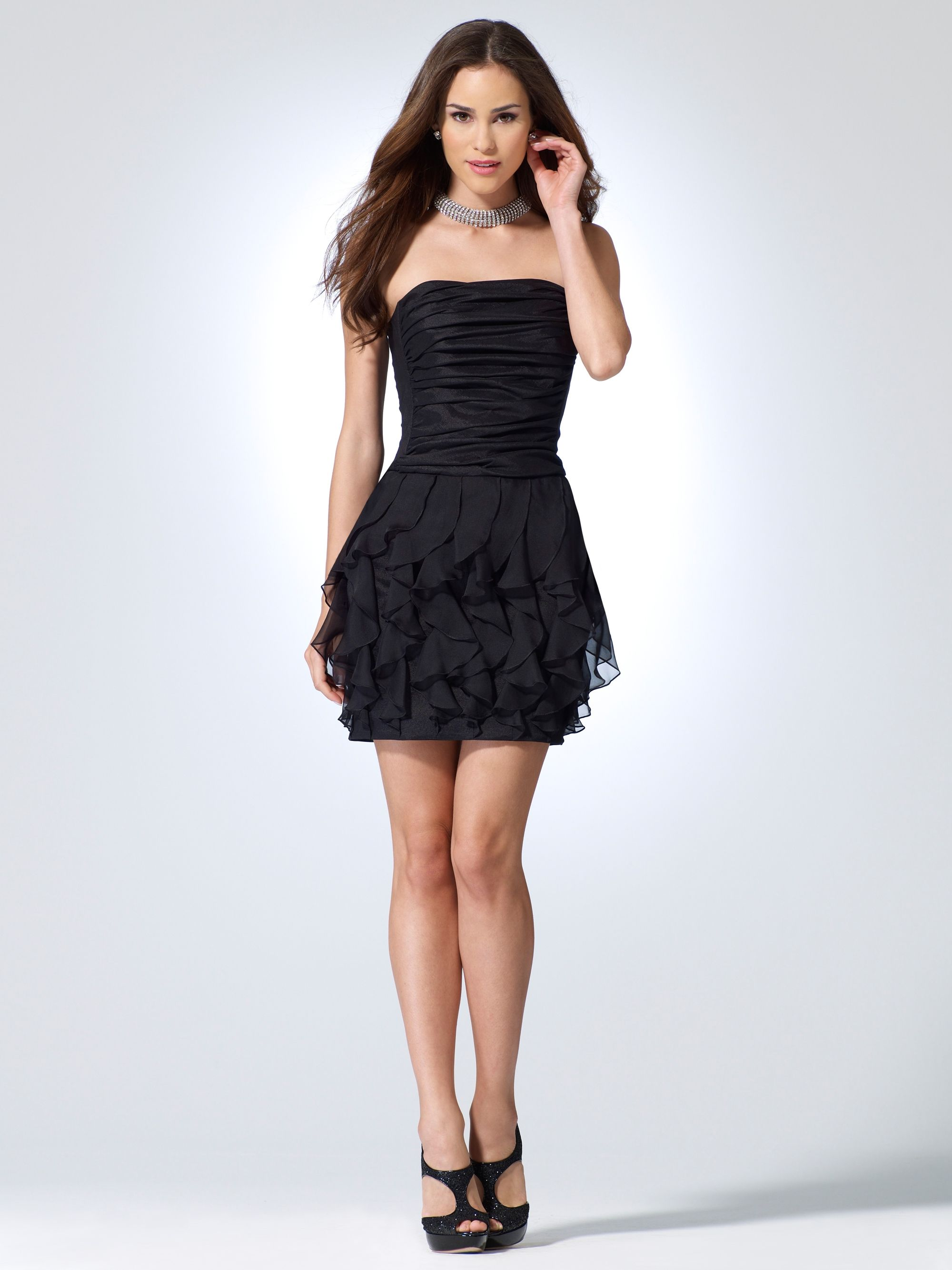 Cache'. Such an awesome summer dress. It's about $178 but you can wear this for awhile.Timeless black for me!