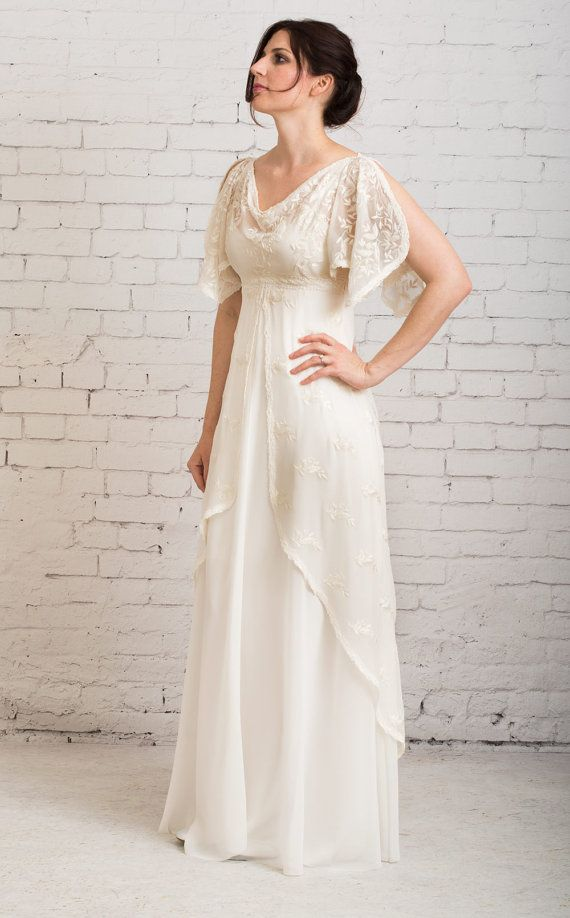 Gown Of Flowing Silk Chiffon Embroidered And Beaded Open Style Flutter Sleeves With Gracefully D Cowl Neckline Under Layer