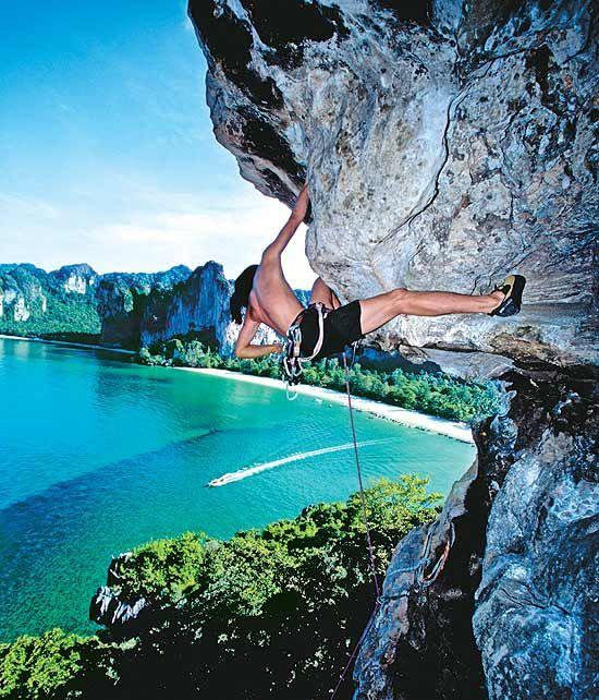 Rock Climbing Off A Limestone Cliff Railay Beach Krabi Province Thailand
