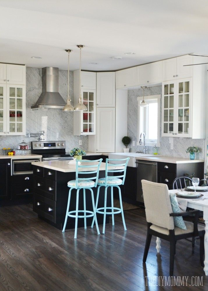 A beautiful vintage industrial kitchen featuring black and white ...