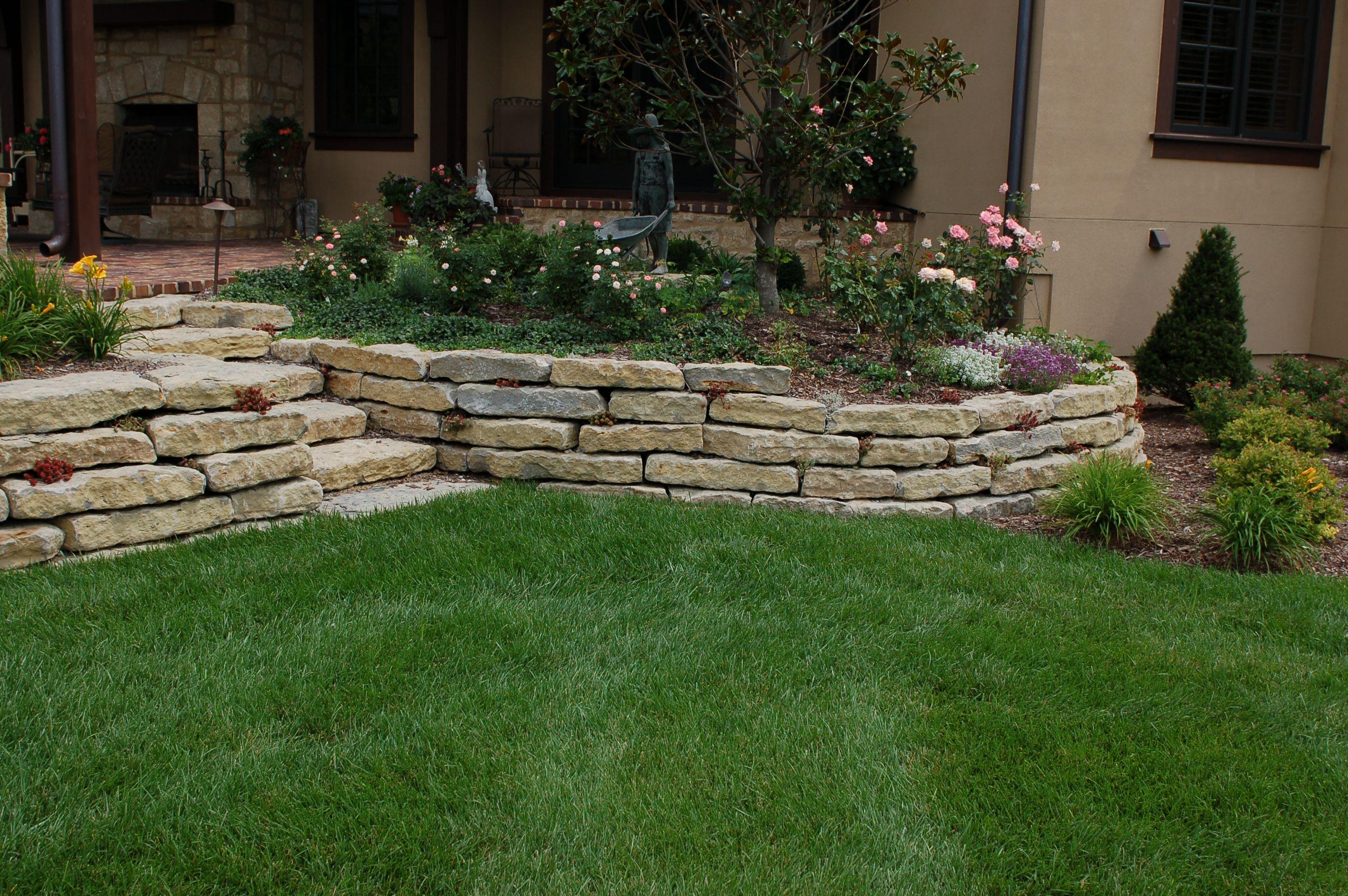 "6"" limestone retaining walls and steps. #TopekaLandscape"