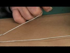 Video: How to Add Hanging Wire to Photo Frame | eHow | contains a great cinching tip that helps secure insulated framing wire
