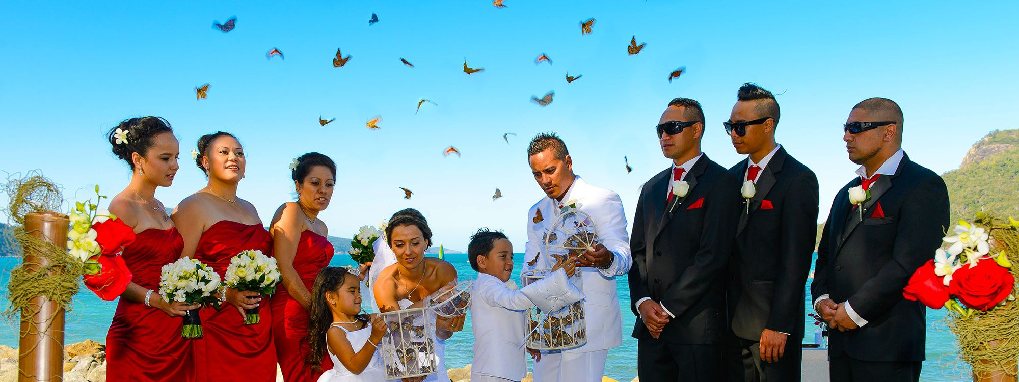 children help release butterflies at conclusion of wedding