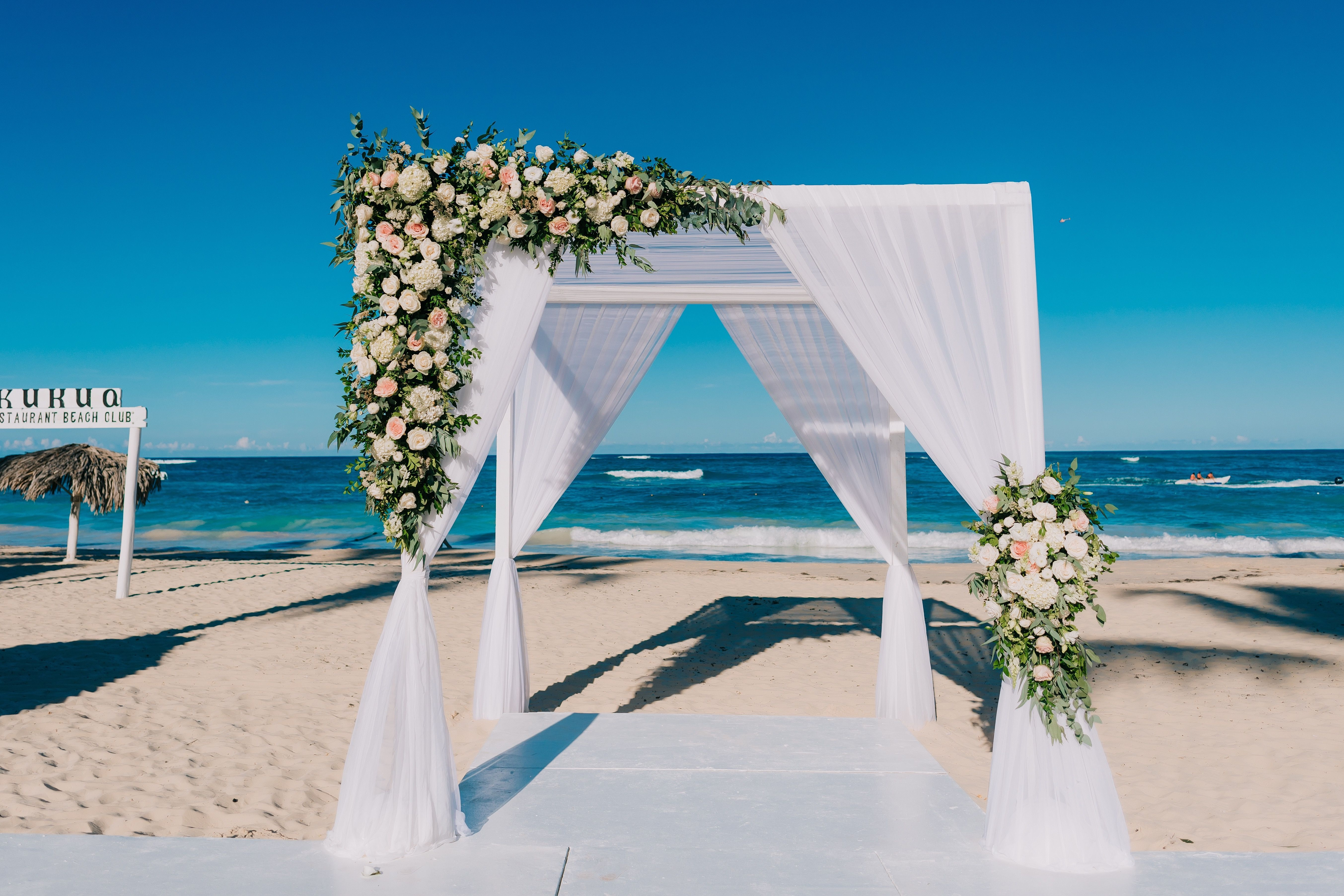 This Romantic Beach Gazebo Set Against The Blue See And Sky Is