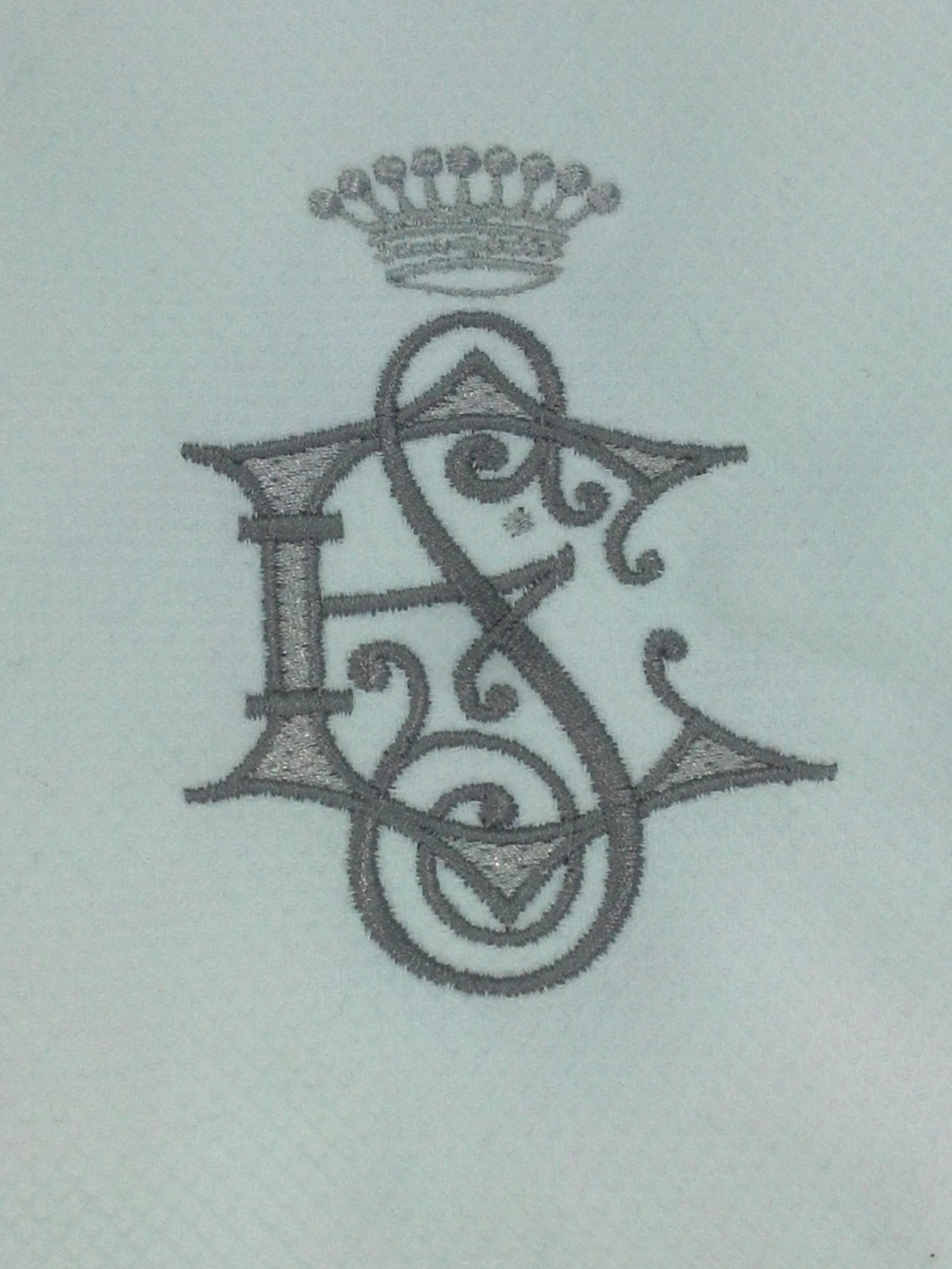 $20 French pique guest towel with regal 2 letter monogram and crown